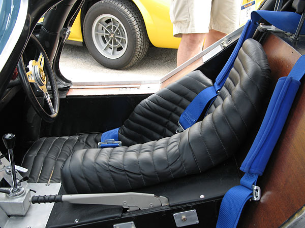 Custom leather-upholstered racing seat.