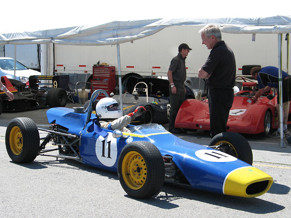 In the background here you can glimpse Bernard's other racecar: a lovely blue Elva MkVII.