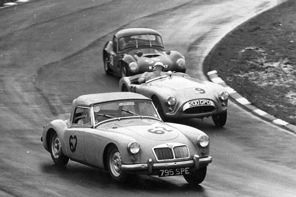 Colin Hextall races Bill Shaw and W. Evangelista at Brands Hatch's Easter Meet, 3 April 1961