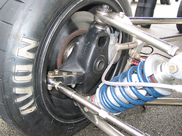 Brabham proprietary magnesium uprights (marked C 1801 2).