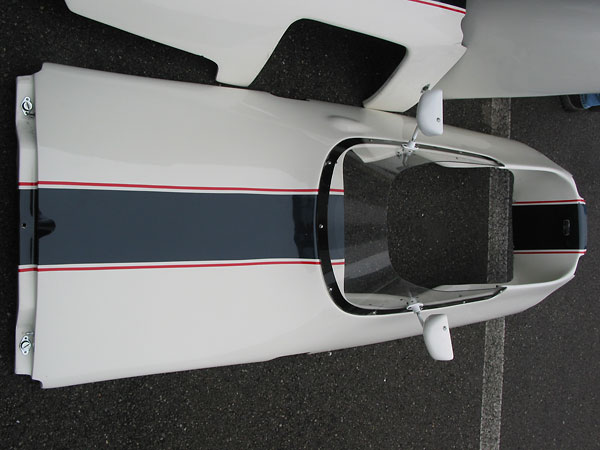 Two Dzus quarter-turn fasteners hold down the front of the cowl panel on a Brabham BT30.