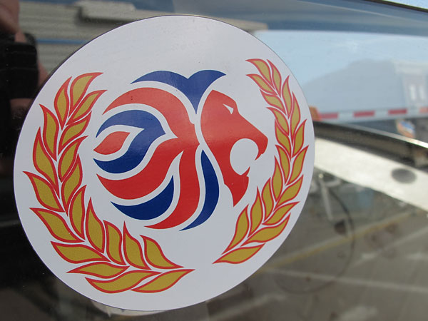 Stylized lion / union jack logo sticker.