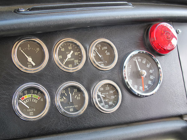 Stewart Warner gauges: fuel pressure, oil pressure, oil temp, voltmeter, ammeter, and water temp.