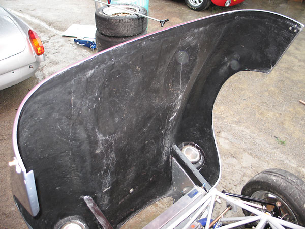 The Ginetta G4 fiberglass bonnet pivots forward for excellent access to the engine.