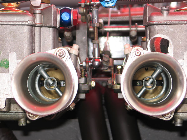 Dual Weber 40DCOE carburetors with short velocity stacks.