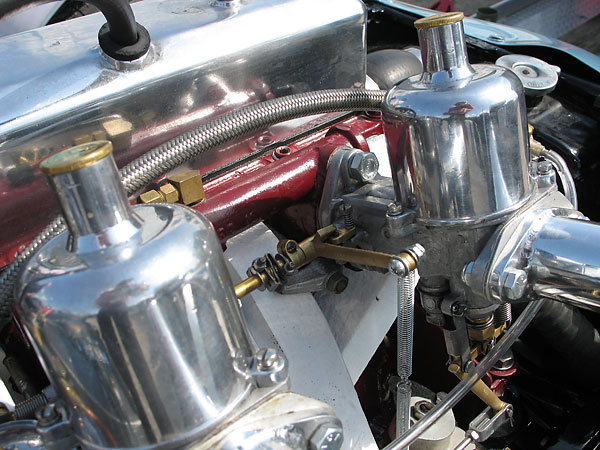 Twin 1.12 inch S.U. carburetors with long velocity stacks.
