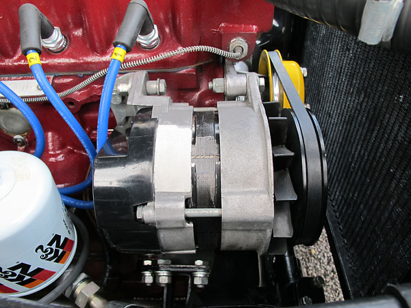 Lucas alternator with oversize pulley.