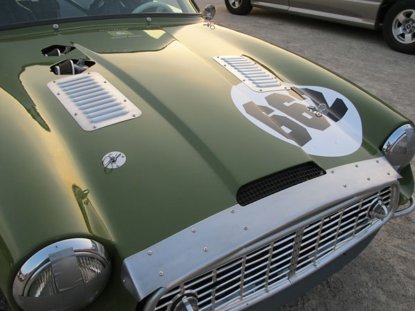 Dennis created louvered aluminum panels to cover holes in the 2500M bonnet.