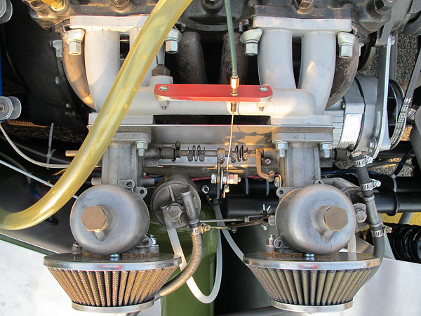 Dual S.U. H6 carburetors mounted on a Triumph TR4 aluminum intake manifold.