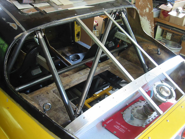 The eyebolts seen here will come in handy later, when the body is lowered onto the frame.