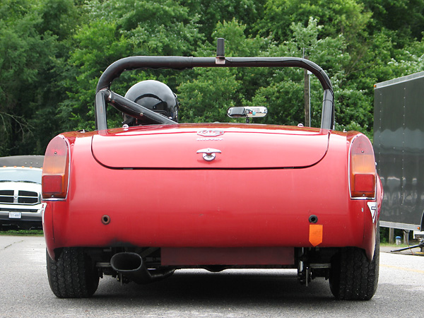 Tail light lenses are from a later model (1970 or later) MG Midget.
