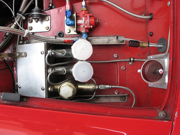Dual Girling master cylinders with bias bar.