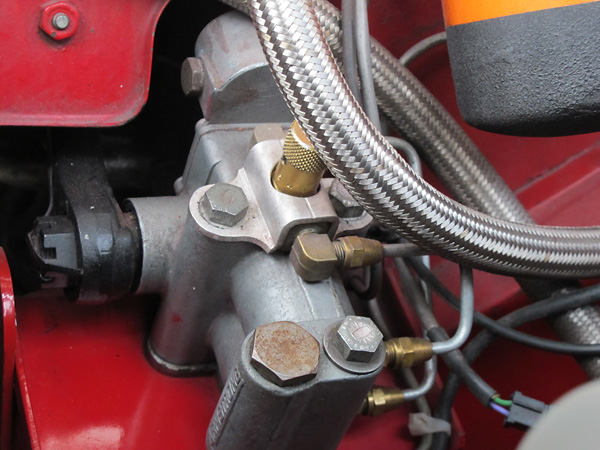 The remote mounted flow control valves have knurled brass knobs. Craig advises they're set rather firm.