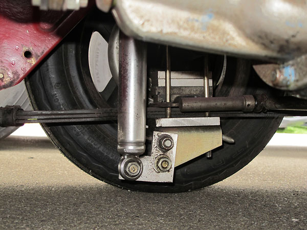 Carrera telescoping rear shock absorbers.