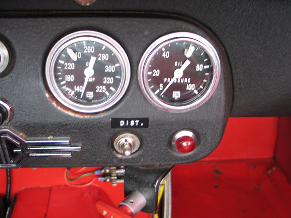 Stewart Warner oil temperature (140-325F) and oil pressure (5-100psi) gauges.