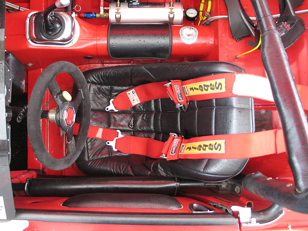 Pads for both elbows! At the top of the photo, you can also see the Accusump oil accumulator.