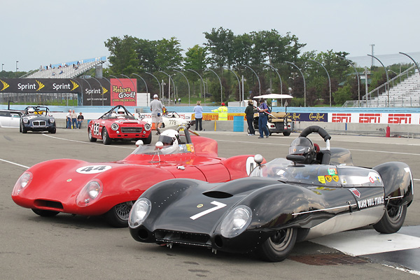 Dudley Cunningham's Lotus 15 shares victory lane with Glenn Stephens' Lotus Eleven.