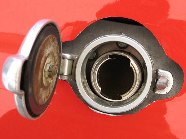 A modern fuel cell liner with a more secure filler cap is hidden underneath.