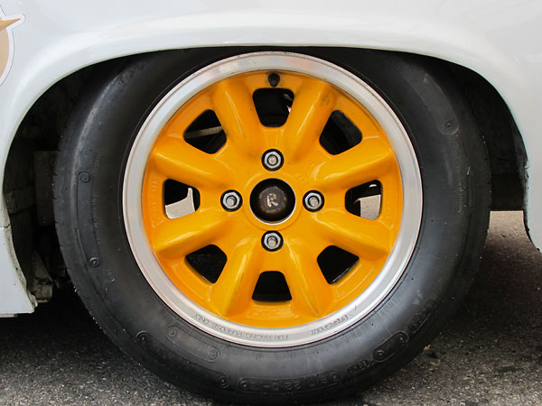Panasport Racing 13x6 aluminum wheels.