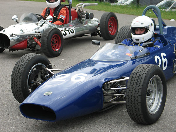 (It must be hard to concentrate with rather odd homebuilt racecar parked next to your Merlyn.)
