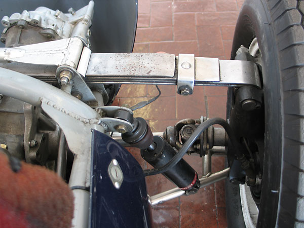 As with the front suspension, leafsprings are called on to locate the upper ends of the hub carriers.