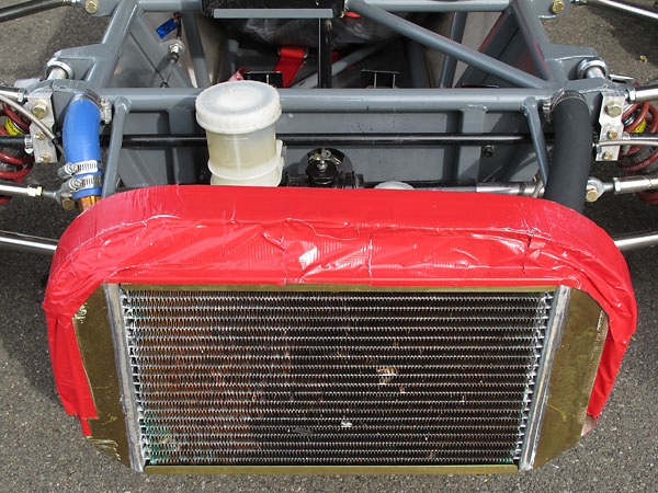 Alexis Mk14s came with combined water and oil copper/brass radiators. (Here, the oil cooler isn't in use.)