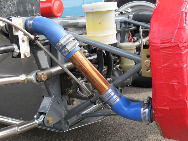 Engine coolant is routed through the upper longitudinal frame tubes.