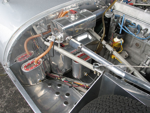 Notice the pressurized coolant header tank, high on the firewall where it belongs.