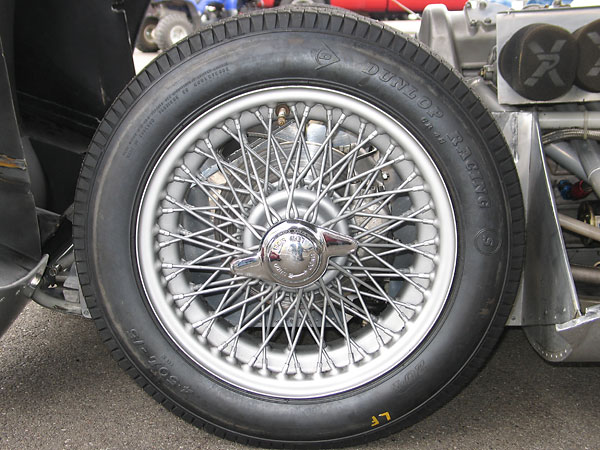 Dayton 72-spoke 15x5 wire wheels with Dunlop Racing bias-ply tires.