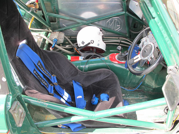 Kirkey aluminum racing seat and Willans six point cam-lock safety harness.