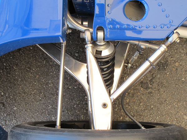 Wide-based one-piece lower control arms mount to the tubular steel radiator subframe.
