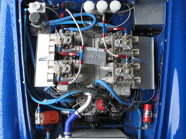 Four Weber 50DCOE carburetors mounted on JE Developments swan neck manifolds.