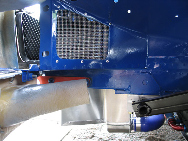 Cooling airflow from the oil coolers is ducted into the wheel wells.