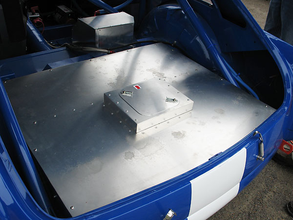 A twelve gallon ATL fuel cell is mounted under this fireproof aluminum cover...