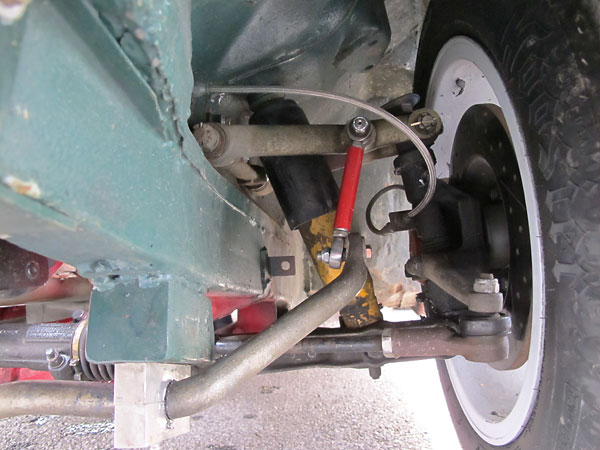 There are no common parts between MGB and MGC front suspensions.