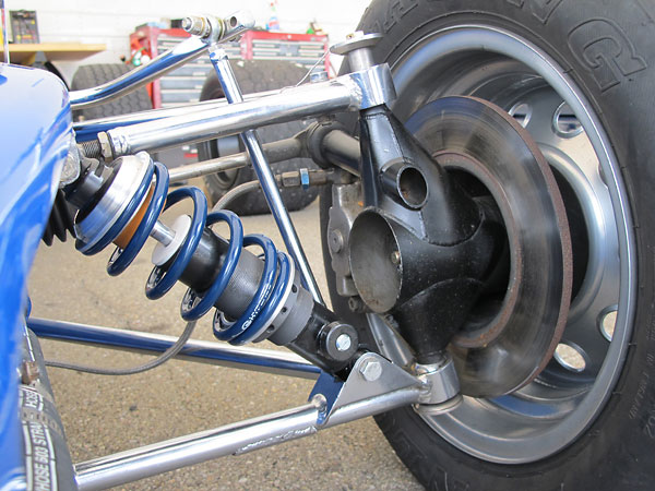 Lola proprietary fabricated steel front uprights featuring live stub axles.