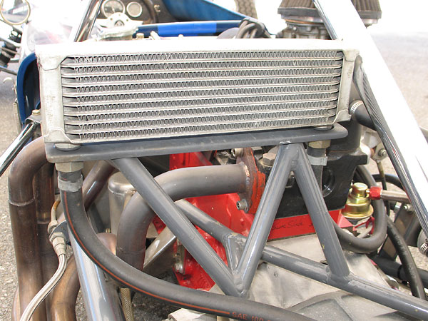 10-row aluminum oil cooler on a robust mounting bracket.