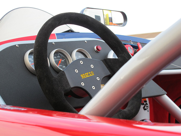 Sparco suede wrapped, D-shaped steering wheel.
