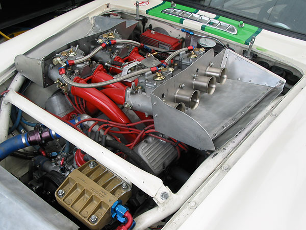 The manifolds are fed by four Weber 48DCOE two-barrel, side-draft carburetors.