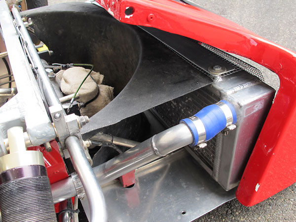 After passing through the radiator, airflow exhausts to the sides.