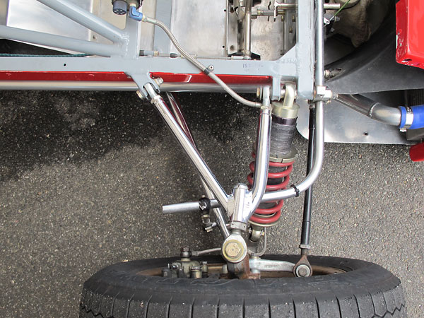 Outboard shock absorbers are usually oriented perpindicular to a car's longitudinal axis.