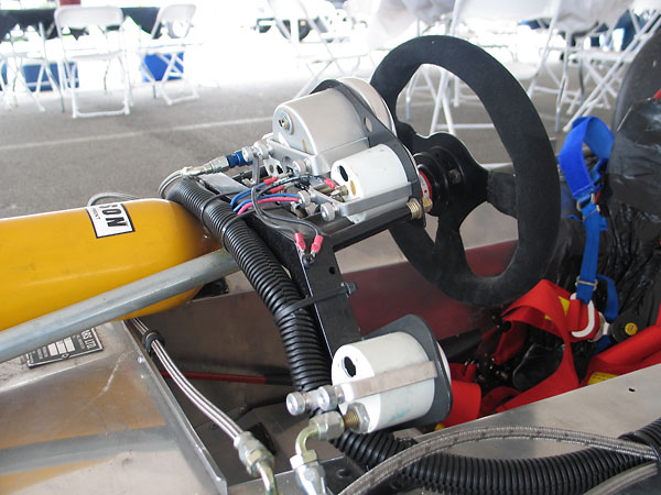 On the Lola T192, instruments are mounted to a simple arch constructed of steel box tubing.