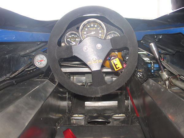 AutoMeter Carbon Fiber Ultra-Lite water temperature, tachometer, and oil pressure gauges.