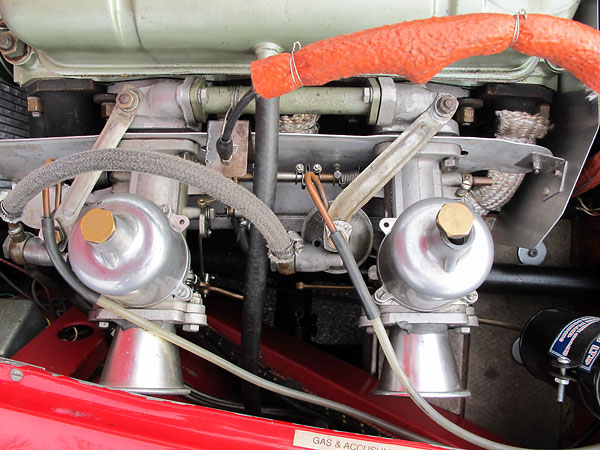 Dual S.U. H6 (1.75) carburetors, with velocity stacks.