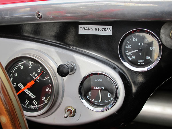 Moroso tachometer (0-11000rpm), Lucas ammeter, and Smiths oil temperature gauge (40-140C).