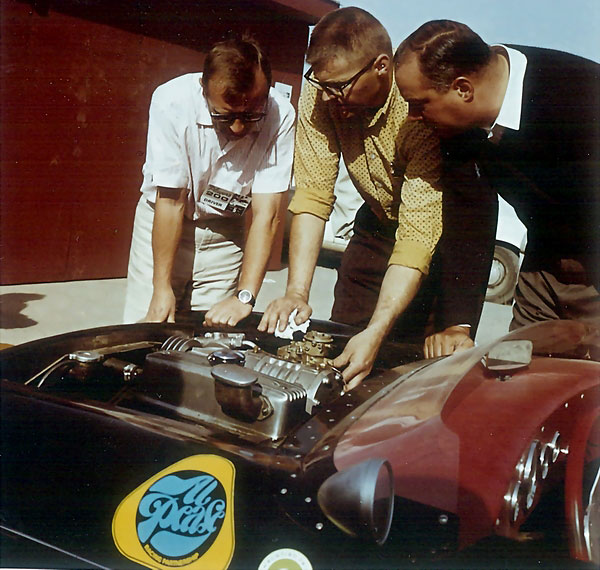 John Camden (center) helps Al Pease (left) dial in the Carter carburetor for the 1964 Player's 200 race.