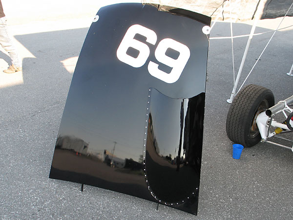 For the restoration, Al Pease leant Mike Adams the original cardboard pattern for cutting the car's number (69).