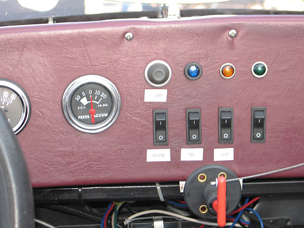 Start pushbuttom. Left-to-right: Ignition, Fuel, and Light rocker switches.