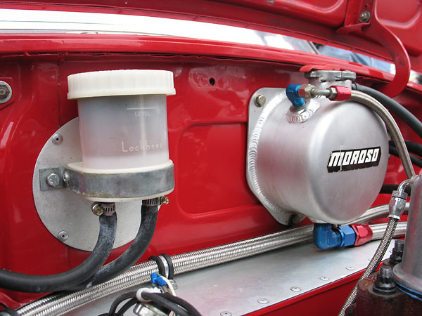 Lockheed brake fluid reservoir and Moroso cooling system expansion tank.