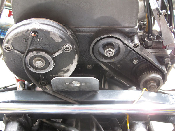 Left: an alternator. Right: belt drive for the Lucas mechanical fuel injection metering unit.